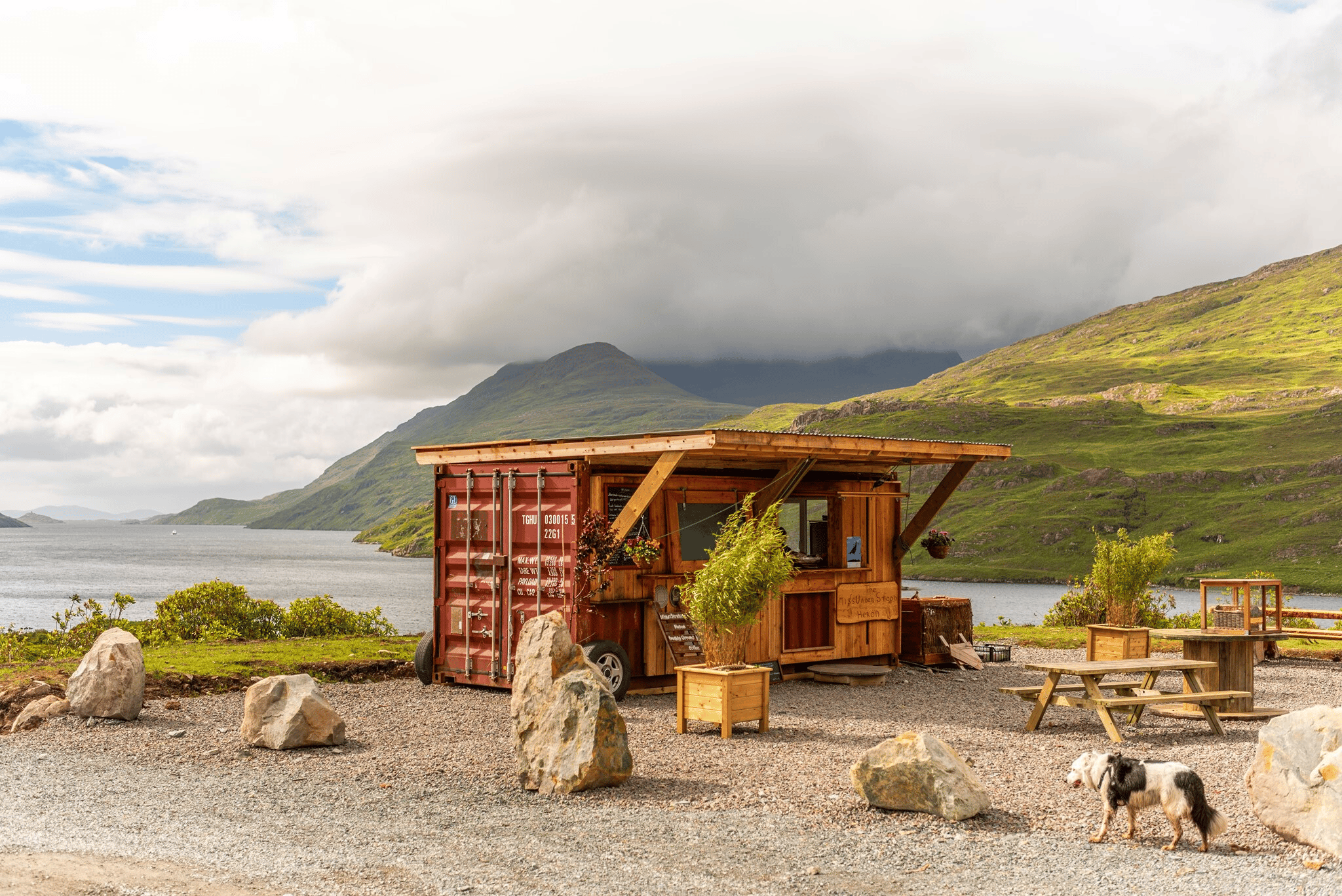 food truck with a fjord and mountains in the background
